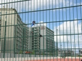 large-fence-surrounding-a-tennis-court-in-lisbon