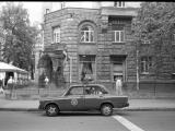b&w analog film photo: Kiev police car
